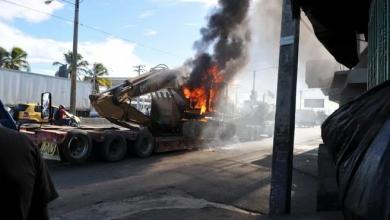 Photo of Desalojo en kilómetro 11 de autopista Duarte provoca enfrentamiento entre moradores y policías